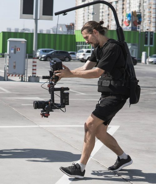 Image of our staff at Elite Video of Fort Myers shoowing some footage out in a parking lot.